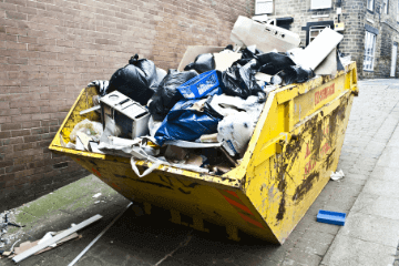 skip full of mixed rubbish