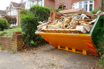 skip full of mixed building waste